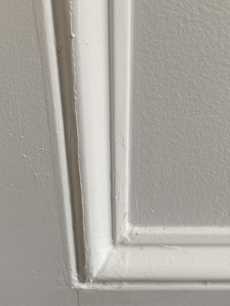 Bad Caulking on a wainscoting wall