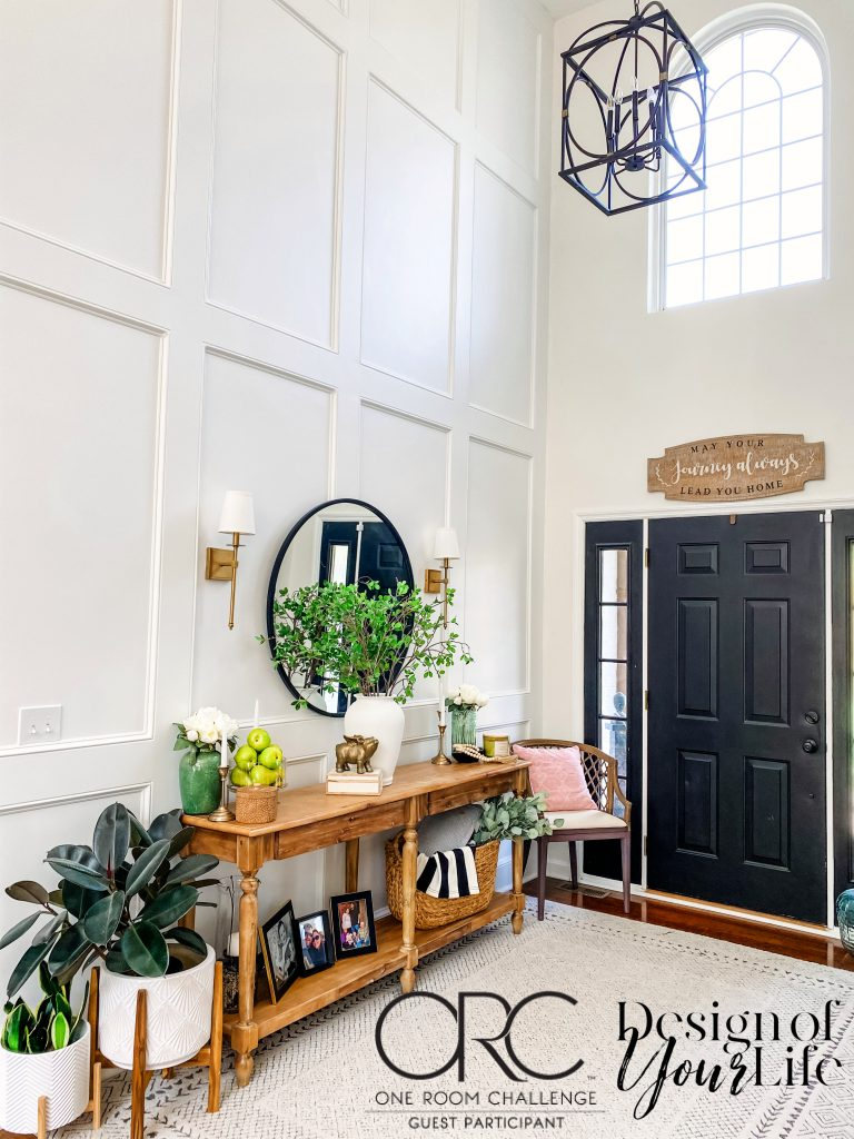 DIY two-story recessed panel wainscoting with styled foyer table