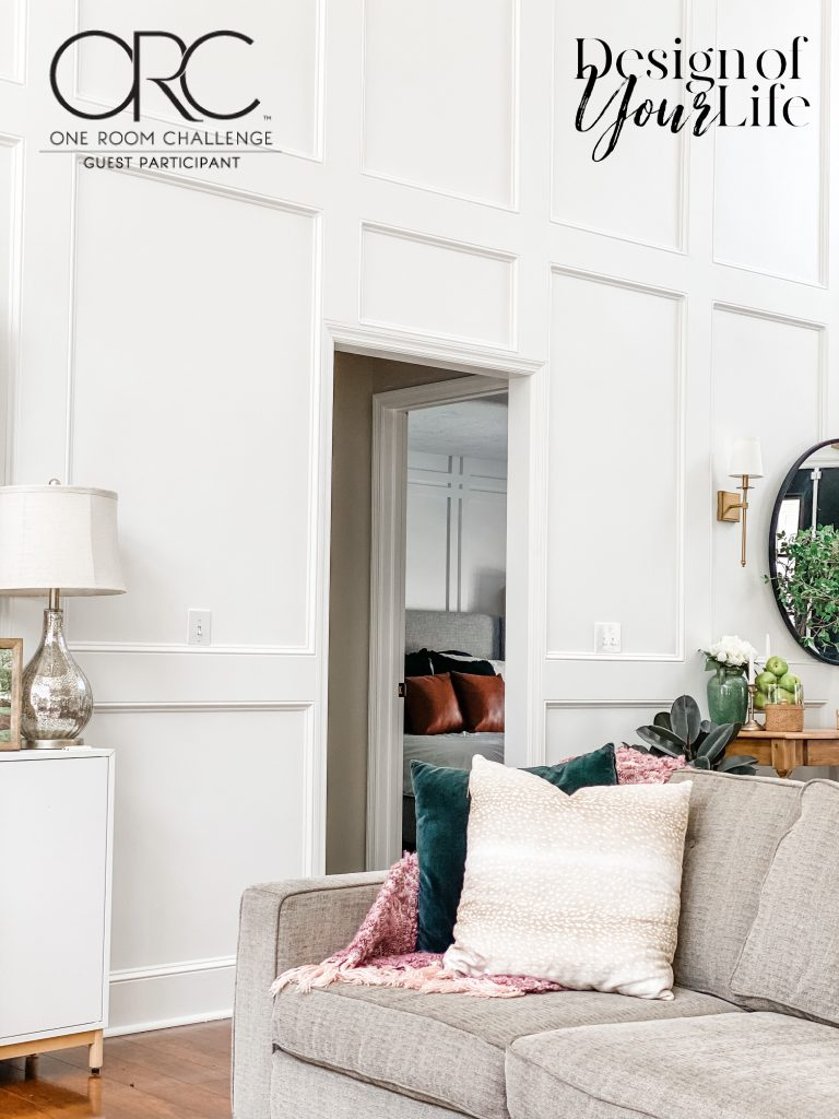 two feature walls, wainscoting and board and batten, visible from living room